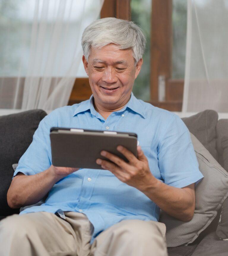 Asian Senior Men Filling out an online Form